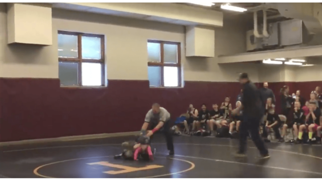 Little boy tries to rescue sister during her wrestling match