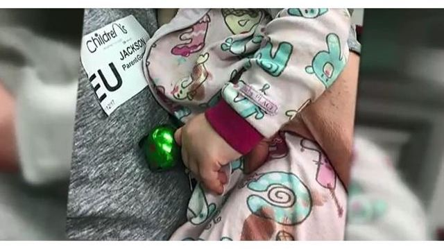 Parents issue warning after baby nearly loses finger to jingle bell